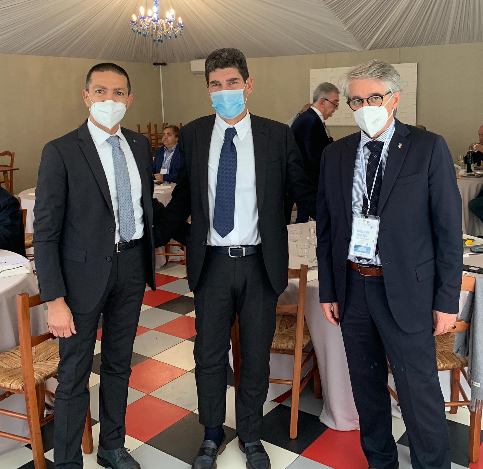 Favre insieme al Presidene De Sanctis e allaltro vice Rosati